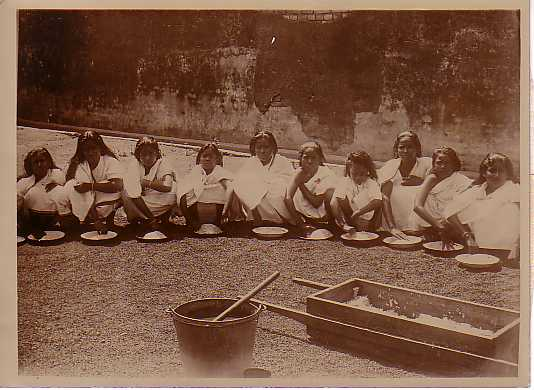Rice-cleaning being done by girls at a mission school