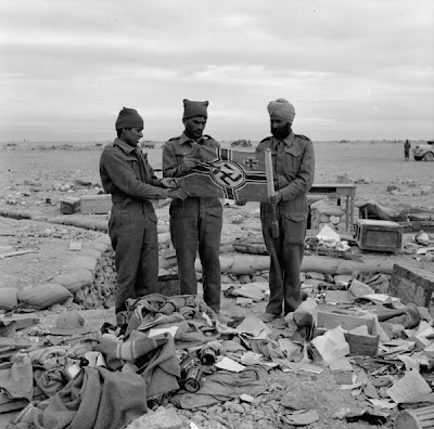 world war 2 pictures of soldiers. Indian soldiers holding a Nazi