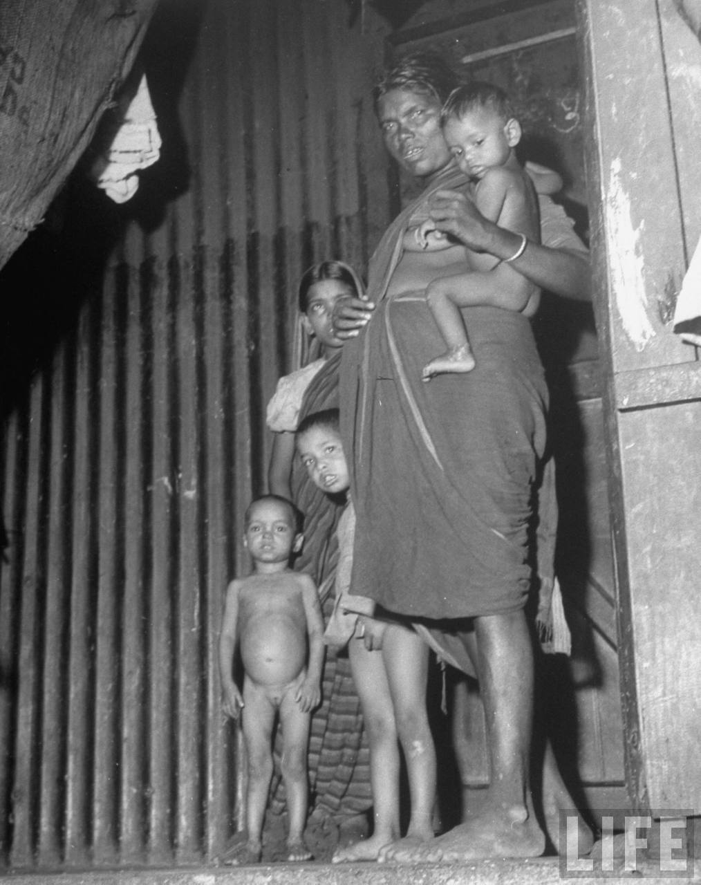 Indian mother with her children in their quarter in the poor section