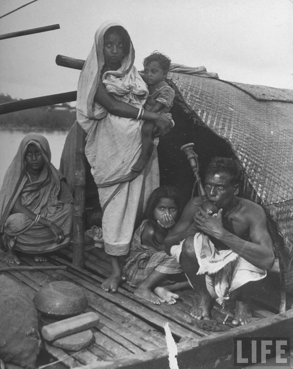 Indian family on river boat where they live - 1946