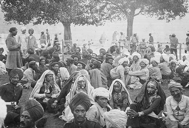Group of Indian men and women, including soldiers in uniform, Chamba, India, ca. 1899