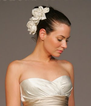 two flowers on updo wedding hairstyle