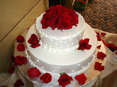tiered Tiffany Blue cake Red roses arranged on top of a white wedding