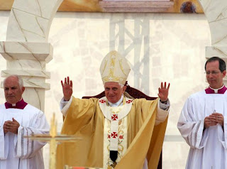 Pope Benedict XVI blessing during the celebration Mass at a stadium in Amman, Jordan image