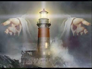 God Jesus Christ saving hands with light house background religious Christian photo
