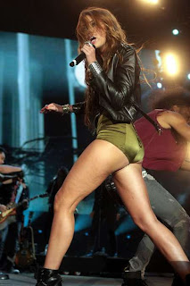 Miley Cyrus in  racy Green Leotard on stage