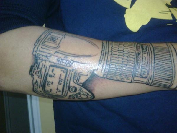 9 - Nikon DSLR tattoo