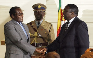 Robert Mugabe and Morgan Tsvangirai Shaking Hands at Signing of Agreement