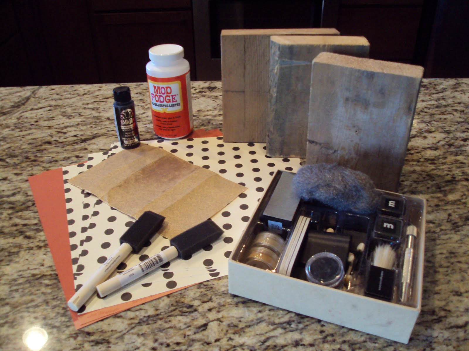 How to put scrapbook paper on wood - For This Project You Will Need Halloween Scrapbook Paper Blocks Of Wood Sand Paper Black Paint Mod Podge Two Paint Brushes And Black Ink Or A