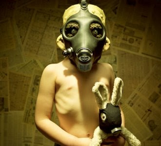 child wearing a gas mask
