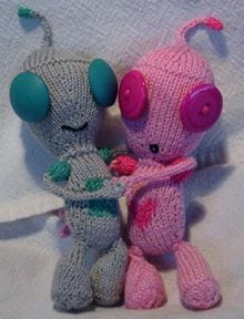 photo of two knitted robots
