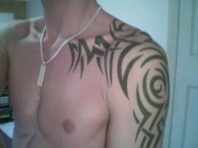 cool tribal tattoo. Cool Tribal Shoulder Tattoos