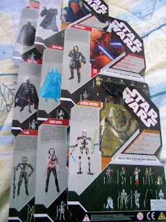 Star Wars 30th Anniversary Dark Side Sith Emperor's Shadow Guard with exclusive Star Wars Force Unleashed cheat codes 4-Lom from The Empire Strikes Back Darth Maul Saga Legends Darth Vader from Revenge of the Sith Battle Damaged Darth Vader with exclusive Star Wars Force Hologram figure collector's coin Empire Strikes Back General Greivous Maris Brood
