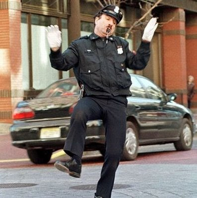 traffic-cop-dancing-on-work-in-traffic