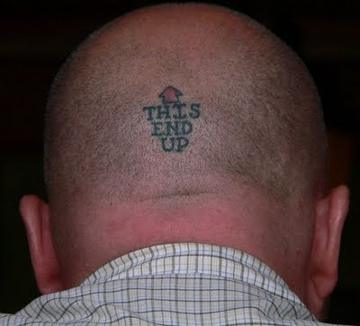 tatto-on-head-saying-this-side-up
