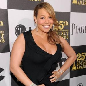 My boyfriend insists that Mariah Carey is not depicted on the 1995 album cover Daydream. Is she?