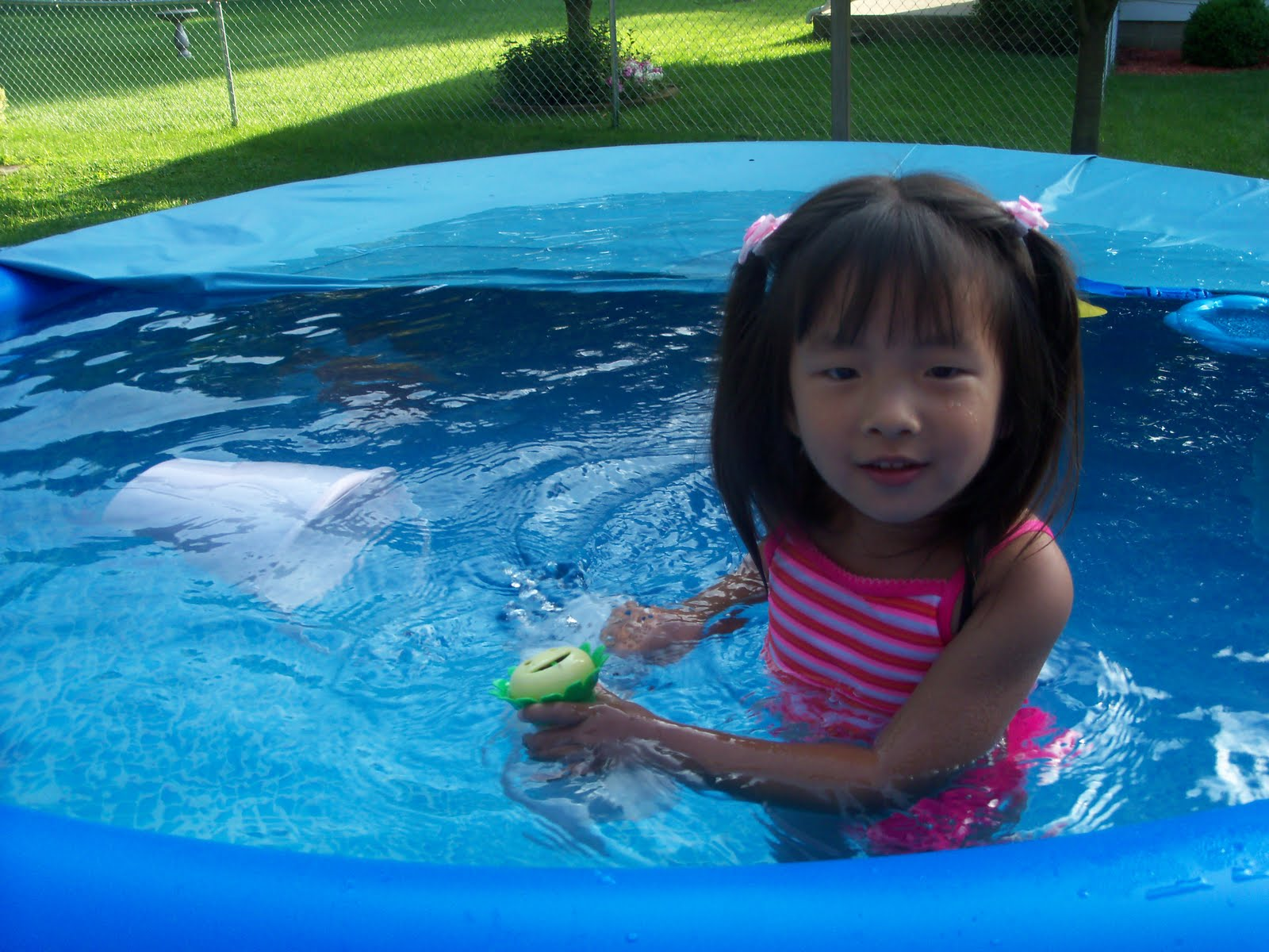 While she was playing in the pool I was near by pulling weeds. #0B4071