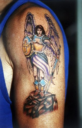 SciFi and Fantasy Art Crying Angel by Stacey ´Pagan´ Gourves If there was an angel tattoo design made for men, the archangel is it.