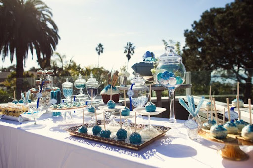 and aqua to teal were blended with warm amber glassware silver and gold