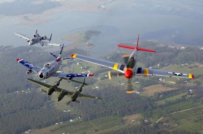 An A-10 Thunderbolt II, F-86 Sabre, P-38 Lightning and P-51 Mustang fly in a heritage flight formation during the air show at Langley Air Force Base, Virginia.