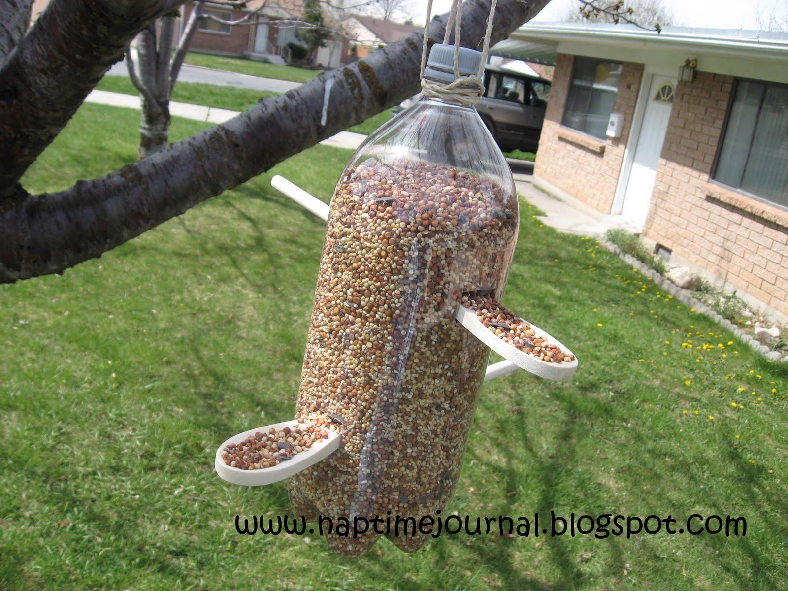 Bird feeder out water bottle bird feedersbird feeders for How to make a bottle bird feeder