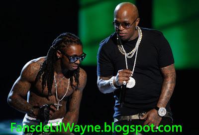 Imagen de Lil Wayne y Birdman en una actuacion