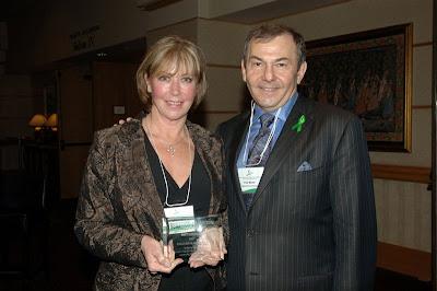 Patti Leonard, Hamilton Health Sciences, receives the Donation Champion award from Frank Markel, President and CEO of TGLN