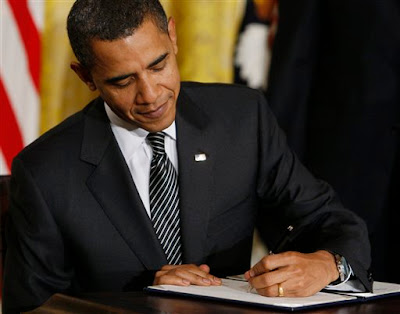 Obama signs health care