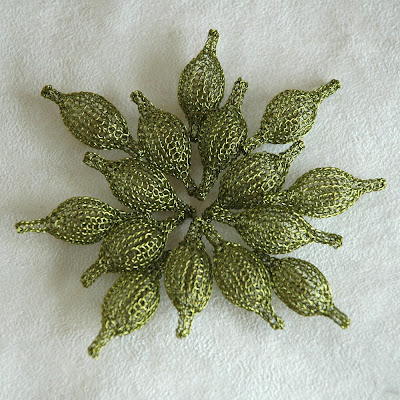 green wire crochet pods