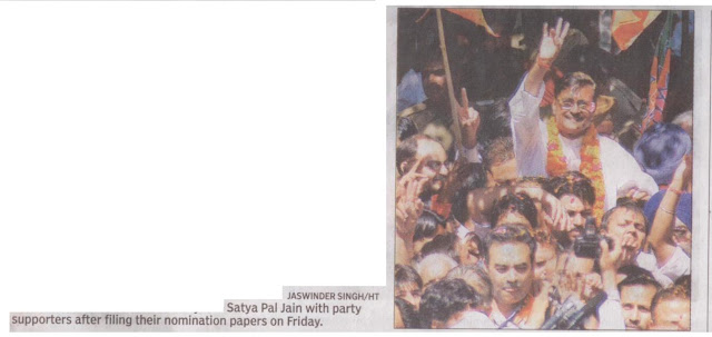 Satya Pal Jain with party supporters after filing their nomination papers on Friday.