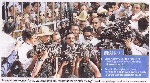 Satyapal Jain, counsel for the state government, meets the media after the high court proceedings on Monday
