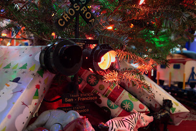 heres todays shot of our indoor live christmas tree it has a circus train hence the farm animals i love this new camera i took this shot by plugging - Train Under Christmas Tree