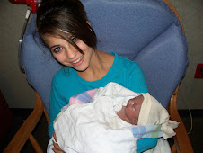 Rachel Elaine being held by her big sister Kelly