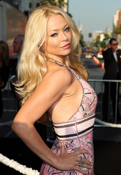Charlotte Ross paired her blue one-shoulder dress with nude platform heels.