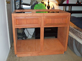 Stained and drawer fronts mounted both false face and real