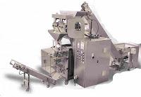 impianto completo di confezionamento in buste con sistema di caricamento a canali vibranti del prodotto da confezionare.