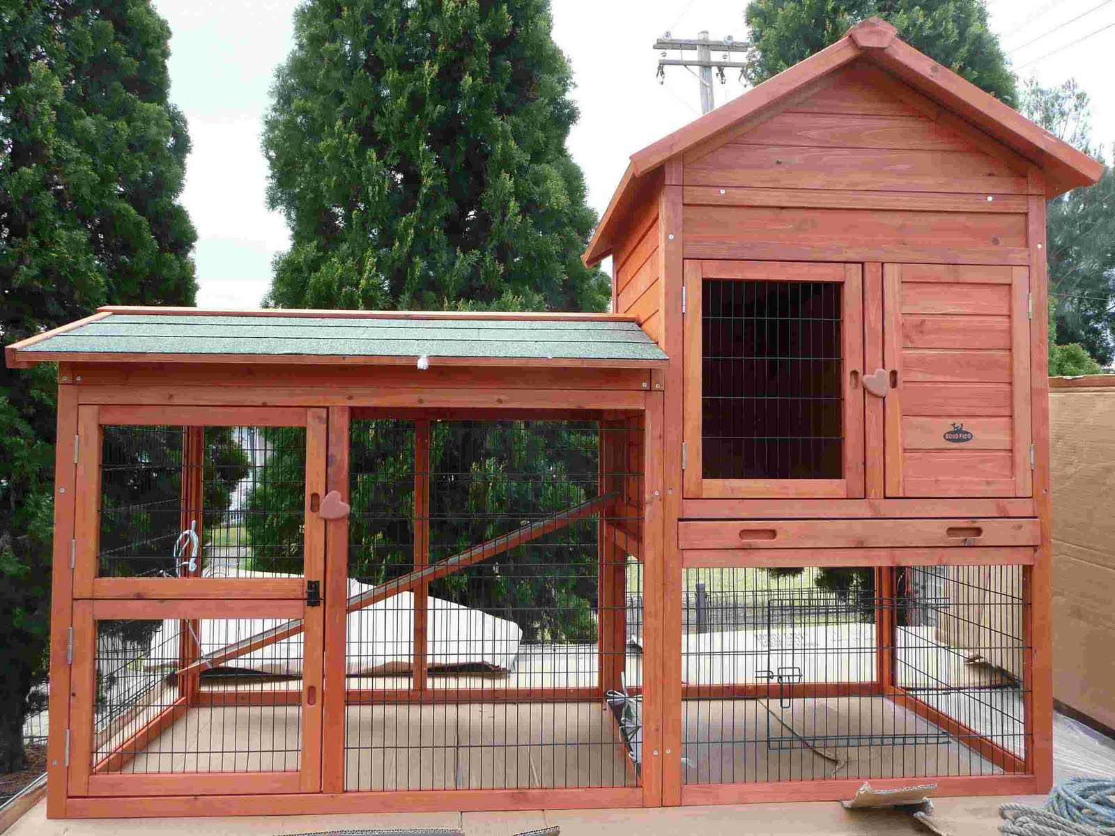 Rabbits and rabbit hutches for Awesome rabbit hutches