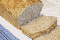 color photograph of a sliced beer bread loaf