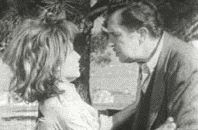 still cropped image of the main character confronting a surviving woman from the black and white film 'The Last Man on Earth' starring Vincent Price