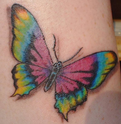 butterfly foot tattoos. utterfly tattoo