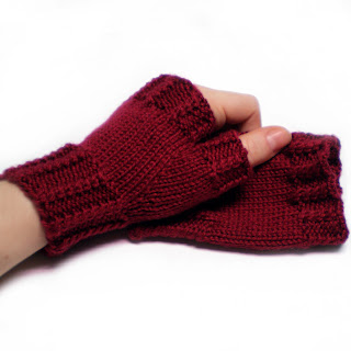 red knitted bamboo wool fingerless gloves wrist warmers with cables