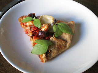 a slice of ratatouille pie with fresh lemon basil