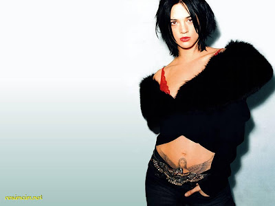Asia Argento black fur top tattoo 1024x768 (click on the image to see full