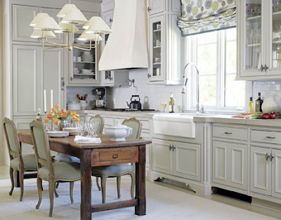 In this soft cream kitchen the upper cabinets showcase decorative stained  glass. I am a fan of mixing old