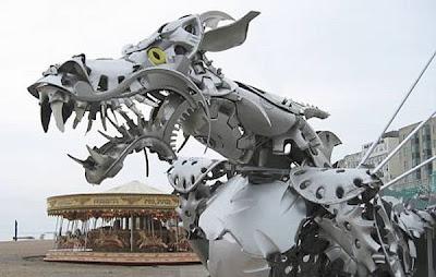 Brilliant hubcap sculptures Seen On www.coolpicturegallery.net