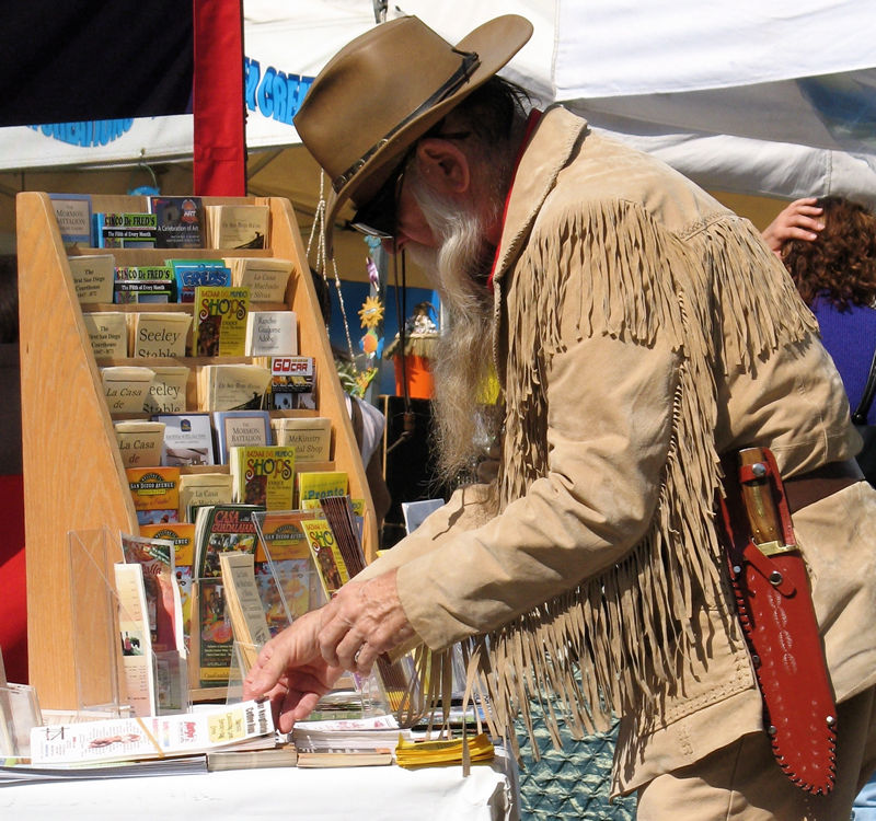 the mountain man arranges his brochures; click for previous post