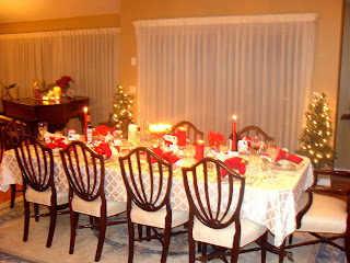 A dining room table decorated with candles