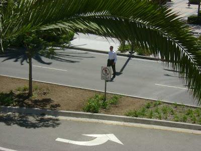Man Approaching Sign