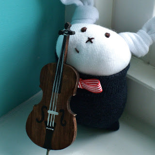 sock bunny playing cello