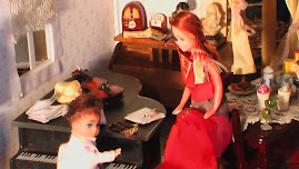 learning the piano with April doll